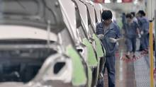In China, an initial reading of manufacturing activity in September from HSBC showed another contraction. (Eugene Hoshiko/The Associated Press)