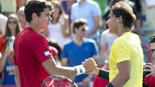 Canada's Milos Raonic, left, congratulates Rafael Nadal, of Spain, for winning the final at the Rogers Cup tennis tournament in Montreal on Sunday, August 11, 2013. (PAUL CHIASSON/THE CANADIAN PRESS)