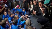 Federal Liberal leader Justin Trudeau speaks to children at a space camp during a visit to the Cosmodome Tuesday, July 21, 2015 in Laval, Que. (Ryan Remiorz/THE CANADIAN PRESS)