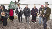 Actor Ethan Hawke, right, attends the Mi'kmaq community's water ceremony on the shores of Pomquet Harbour to support the aboriginal call for a moratorium on oil and gas exploration in the Gulf of St. Lawrence, near Antigonish, N.S. (Andrew Vaughan/THE CANADIAN PRESS)