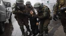 Riot policemen arrest a student protester in Santiago, Sept. 27, 2012. Unlike other OECD countries where about 70 per cent of education is publicly funded, in Chile only about 15 per cent is. (IVAN ALVARADO/REUTERS)