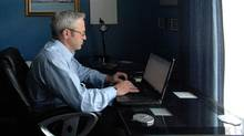 Michael Kennedy is Canadian sales manager for Basic Research Inc, a U.S. based cosmetics company. He is seen here in his home office in Cambridge, Ontario. (Sheryl Nadler)