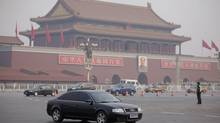 File photo of an Audi car driving past Tiananmen Square in February, 2012. (ZHEYANG SOOHOO/REUTERS)