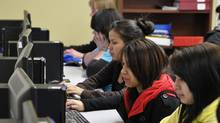Kids can spend time using the computers at the Pathways to Education after school program in Winnipeg. (Robert Tinker for The Globe and Mail/Robert Tinker for The Globe and Mail)