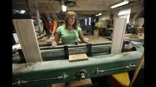 BG Furniture employee Kim Craig prepares pieces of wood for drawers at the company's Walkerton factory. (Deborah Baic/Deborah Baic/The Globe and Mail)