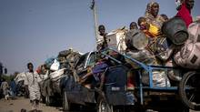 A convoy waits to enter a camp for the internally displaced in Maiduguri, Nigeria, Feb. 12, 2017. An estimated 4.7 million people in northeast Nigeria are desperately short of food and living in a region that is largely isolated from the world after years of brutal clashes between the Nigerian military and Boko Haram. (ASHLEY GILBERTSON/NYT)