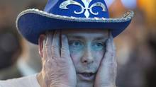 A Parti Quebecois supporter reacts as he watches early election results at the party's reception Monday, April 7, 2014, in Montreal. (Ryan Remiorz/AP)