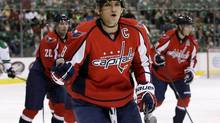 Washington Capitals' Alex Ovechkin (8), of Russia, celebrates as he skates back to the bench after scoring against the Dallas Stars in the first period of an NHL hockey game on Saturday, Oct. 5, 2013, in Dallas. (Tony Gutierrez/AP)