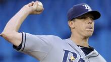 Tampa Bay Rays pitcher Jeremy Hellickson throws against the Toronto Blue Jays during the first inning of their MLB American League baseball game in Toronto April 19, 2012. REUTERS/Mike Cassese (Mike Cassese/Reuters)