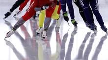 Competitors speed during the women's mass start ISU Speed Skating World Cup event in Berlin. (FABRIZIO BENSCH/Reuters)