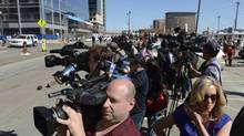 Crowds of media and members of the public gathered outside the John Joseph Moakley Courthouse in Boston on April 17, 2013, after news was reported that authorities had a suspect in custody related to the recent Boston Marathon bombing, which in the end proved incorrect. (Fred Lum/The Globe and Mail)