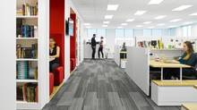 In keeping with its book business, Penguin's new office in Toronto features library-like shelving and reading nooks amid employee desks. (Steve Tsai/Penguin Random House)
