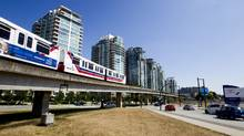 Vancouver-region transit police say some passengers have become convinced they can pry open the doors of stalled SkyTrain cars since a pair of shutdowns across the light-rail system last month. The result: a new effort to fine offending passengers $115. (Ben Nelms for The Globe and Mail)