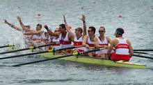 Canada's men's eight rowing team members Jeremiah Brown, right to left, Andrew Byrnes, Conlin McCabe, Will Crothers, Rob Gibson, Brian Price, Malcolm Howard, Gabriel Bergen, and Douglas Csima celebrate their silver medal at Eton Dorney during the 2012 Summer Olympics in Dorney, England on Wednesday, August 1, 2012. (The Canadian Press)