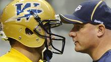 Winnipeg Blue Bombers head coach Paul LaPolice (R) and quarterback Buck Pierce run through plays during practice at the start of Grey Cup week in Vancouver, British Columbia, November 23, 2011. The Winnipeg Blue Bombers will play the BC Lions at BC Place in the CFL's 99th Grey Cup football game this Sunday. REUTERS/Todd Korol (TODD KOROL)