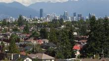 The skyline of Vancouver forms a backdrop for multi-million-dollar homes in the neighbourhoods of Vancouver in August 2011. (Jeff Vinnick for The Globe and Mail)