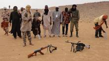 In this May 16, 2012 photo, Islamist rebels from the Ansar Dine faction prepare to pray in the desert just outside Gao, Mali. (Diakaridia Dembele/AP)