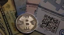A mock bitcoin: Real life requires tight budgeting from students. (JIM URQUHART/REUTERS)
