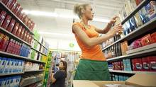 Dollarama employee, Sanaz Shirkhodaeitari restocks shelves at the Dollarama store in Vaughan on August 9, 2010. JENNIFER ROBERTS FOR THE GLOBE AND MAIL Story details: Dollarama has thrived on keeping it simple. A shift toward more expensive products is bringing the retailer into new territory, but the company risks losing its core customers. (JENNIFER ROBERTS/Jennifer Roberts for The Globe and Mail)
