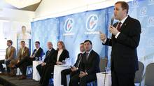Conservative leadership candidate Brad Trost, right, responds to questions from the audience at a Conservative leadership debate in Greely, Ont., on Sunday, November 13, 2016. (FRED CHARTRAND/THE CANADIAN PRESS)