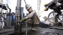 A worker at a Chesapeake Energy oil well near Big Wells, Texas, May 17, 2011. (MICHAEL STRAVATO/NYT)