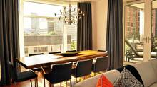 In designing an upscale condo for a Bay Street client, Robyn Clarke desided to create three defined areas in the one narrow space. The space closest to the window was made the dining room. A hanging lamp helped define the area. (Aleksandra Pavlovic)
