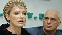 Ukraine's former prime minister Yulia Tymoshenko and her husband Oleksandr are seen in a November 2005 file photo. (Sergei Chuzavkov/AP/Sergei Chuzavkov/AP)