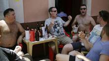 Fans cheer as they drink just off a central square in Manaus, Brazil on Friday, June 13. (Matt Dunham/AP)