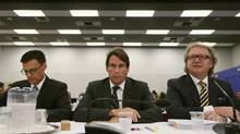 Quebecor CEO Pierre Karl Péladeau, centre, presents his case at the CRTC hearings in Montreal. (CHRISTINNE MUSCHI/REUTERS)