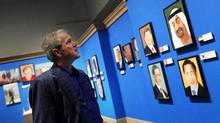 Former president George W. Bush tours The Art of Leadership: A President's Personal Diplomacy exhibit at the George W. Bush Presidential Library and Museum in Dallas on April 1, 2014. (Mona Reeder/AP)