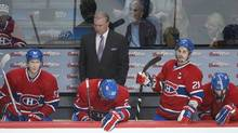 Montreal Canadiens head coach Michel Therrien and players, from left, Lars Eller, Alex Galchenyuk, Brian Gionta and Erik Cole look on from the bench during third period NHL action against the Toronto Maple Leafs in Montreal, Saturday, February 9, 2013. (Graham Hughes/THE CANADIAN PRESS)