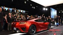 Acura NSX as people bit on it at the Barrett-Jackson auction for charity in Arizona. (Barrett-Jackson)