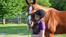 Alessia Fent-Roter, now 15, with horse Maddison at Sans Souci Riding Centre south of Montreal. She is saving to return to the residential camp which specializes in classical horseback riding. (Antonella Tartaglia)