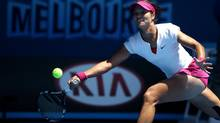 Li Na of China makes a forehand return to Eugenie Bouchard of Canada during their semifinal at the Australian Open championship in Melbourne, Australia, Thursday, Jan. 23, 2014. (Aaron Favila/AP)
