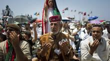 Libyans pray in rebel-held Benghazi on July 15, 2011. (Sergey Ponomarev/AP)