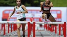 Jessica Zelinka (R) and Brianne Theisen race in the women's heptathlon 100 metre hurdles event at the Canadian Track and Field Olympic Trials in Calgary, Alberta June 27, 2012. (TODD KOROL/REUTERS)