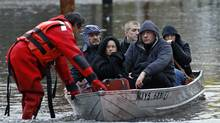 Residents are rescued by emergency personnel from flood waters brought on by Hurricane Sandy in Little Ferry, New Jersey, October 30, 2012. (Adam Hunger/Reuters)