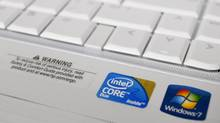 The Intel logo is advertised on a computer at an electronic store in Phoenix, Ariz., in November, 2009.
