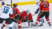 Calgary Flames goalie Karri Ramo (31) makes a save as against the San Jose Sharks during the second period at Scotiabank Saddledome. (Sergei Belski/USA Today Sports)