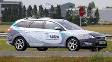 A driverless car during testing at the headquarters of motor industry research organization MIRA at Nuneaton in the West Midlands, England, Wednesday, July 30, 2014. British officials says driverless cars will be tested on roads in as many as three cities in a trial program to begin in January. Officials said Wednesday the tests will last up to three years. Sensors and cameras will guide the cars. (Rui Vieira/AP)