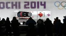 Canada's Justin Kripps and Bryan Barnett compete in a heat of the two-man bobsleigh event at the 2014 Sochi Winter Olympics, at the Sanki Sliding Center in Rosa Khutor February 16, 2014. (FABRIZIO BENSCH/REUTERS)
