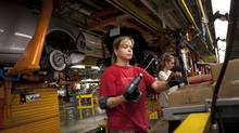 Workers at the General Motors Oshawa assembly plant Aug 22, 2013. About 200 workers make interior components for the Chevrolet Impala assembled in Oshawa. (Moe Doiron/The Globe and Mail)