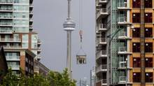 Condominium development in the Liberty Village area of Toronto on June 25, 2013. Even before rates began to spike in May, Toronto condo sales were flagging, with sales down a whopping 55 per cent in the first quarter of 2013 versus a year ago. (Peter Power/The Globe and Mail)