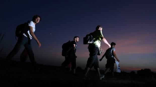 Migrants walk towards the eastern-Croatia town of Tovarnik, close to the border between Croatia and Serbia in September 2015.