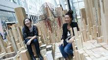 Bi-Ying Miao, left, and Jane Wong are photographed with their exhibit in Toronto, at Migrating Landscapes (Kevin Van Paassen/The Globe and Mail/Kevin Van Paassen/The Globe and Mail)