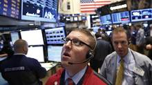 Traders work on the floor at the New York Stock Exchange June 20, 2013. (BRENDAN MCDERMID/REUTERS)