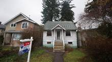 A house built in 1930 that was recently listed for sale for $2.398-million is seen in the Point Grey neighbourhood of Vancouver, B.C., on Friday January 29, 2016. It's missing a few shingles, the bathroom walls show some rot and it needs a paint job, but the tiny home in a tony Vancouver neighbourhood has been listed for nearly $2.4 million and could sell for more. (DARRYL DYCK/THE CANADIAN PRESS)