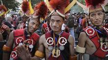 The annual Hornbill Festival offers a glimpse into a slice of life in one corner of the world as tribes from across northeast India showcase their dances, songs, tattoos and elaborate outfits. (Anupam Nath/The Associated Press)