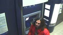 A person of interested is pictured here in what police describe as a giant ATM fraud that stretched around the world. Seven Toronto-area people have been arrested and almost 360 charges laid. (Handout/Toronto Police Services)