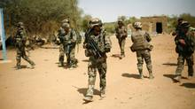 French soldiers secure the area where a suicide bomber attacked, at the entrance of Gao, northern Mali, Sunday Feb. 10, 2013. It was the second time a suicide bomber targeted the Malian army checkpoint in three days. (Jerome Delay/AP)